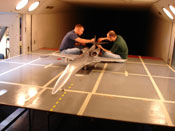 Plane getting worked on in wind tunnel
